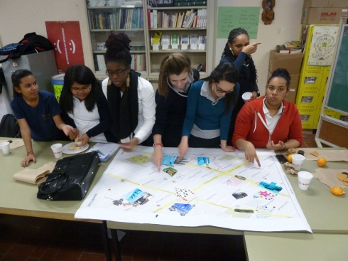 One group working on their creative group cartography, making a collage of what they liked and how they would improve the neighbourhood